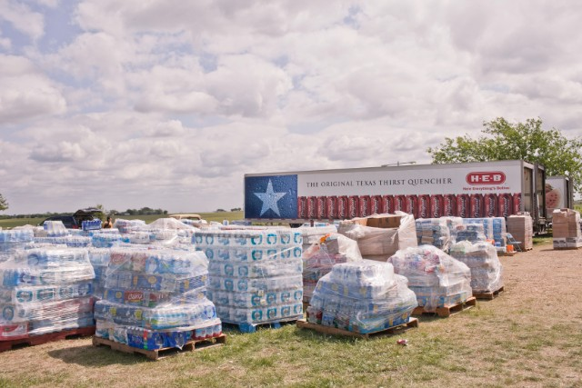 Donations of water stack up at the site of Westfest, a fall celebration of Czech heritage.