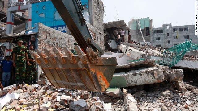 A body is trapped under the damaged building on April 24.