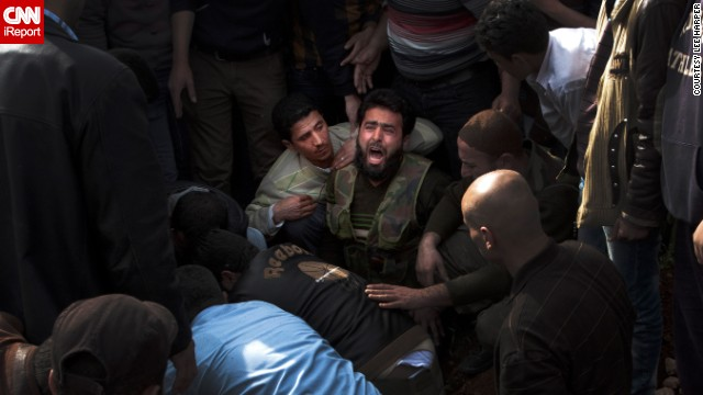 A Free Syrian fighter mourns the death of a friend in Aleppo on March 30, in this photo taken by iReporter Lee Harper.