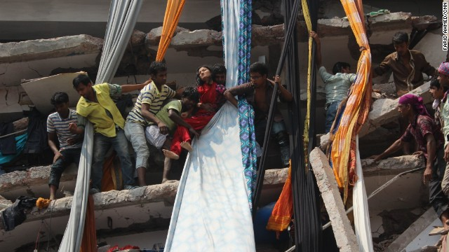 Rescuers help an injured garment worker to escape from the Rana Plaza building on the outskirts of Dhaka on April 24.