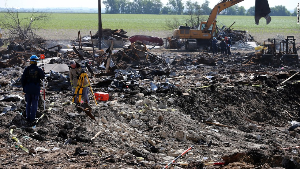 Forensic mappers work the crater at the site of the fire and explosion in West, Texas, on Wednesday, April 24. The plant run by West Fertilizer Co. in the small Texas town exploded on Wednesday, April 17, killing 14 people, most of them emergency responders. Dozens were injured.
