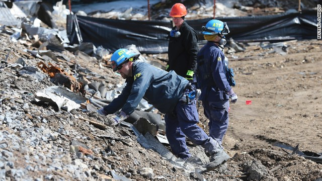Agents from the Bureau of Alcohol, Tobacco, Firearms and Explosives on April 24 search the bank of rail tracks for evidence at the site of the explosion.