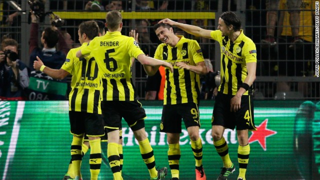 Dortmund's players celebrate with Lewandowski after he becomes the first player to score four times in a semifinal of the competition since Ferenc Puskas in 1960.
