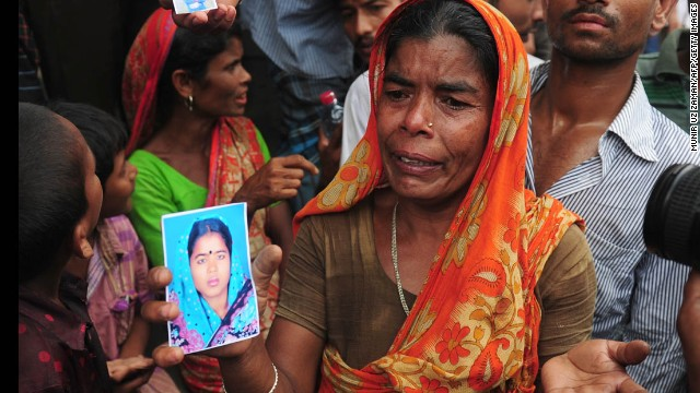 A Bangladeshi woman shows a picture of her missing daughter-in-law she believes is trapped in the collapsed building on April 25.
