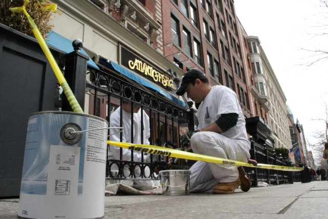 Workers At A Boylston Street Restaurant Paint Over The Damage Caused By Boston Marathon Ings
