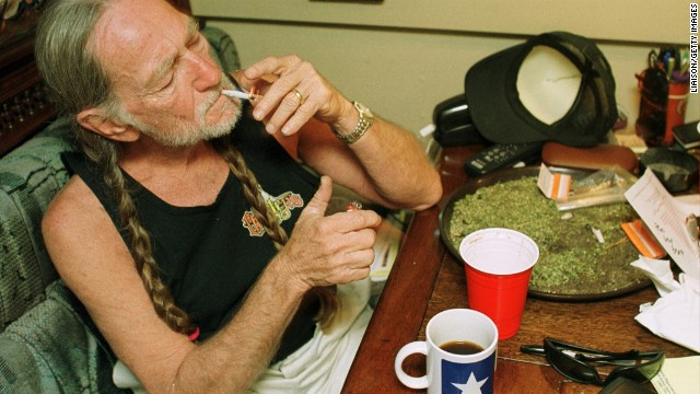 Willie Nelson takes a drag while relaxing at his home in Texas in this photo circa 2000s. Click through to see Nelson throughout his career.
