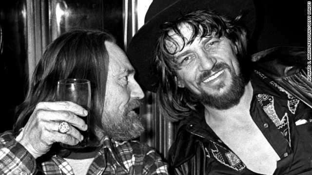 Nelson and Waylon Jennings enjoy a drink together in New York in 1978.