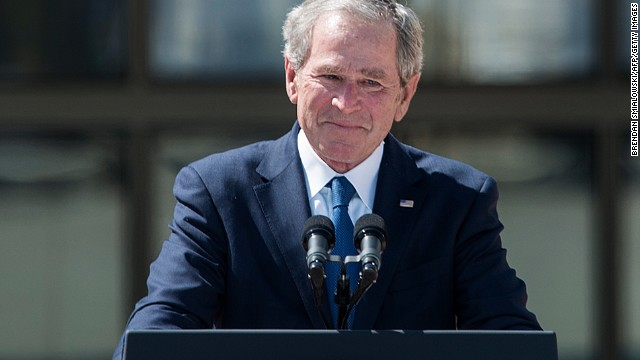 Former President George W. Bush holds back tears as he finishes his speech.