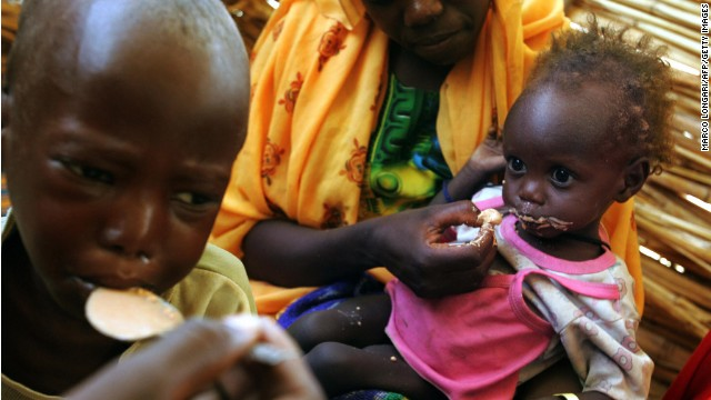 Malnourished Sudanese childre are fed at a camp for people displaced by the war in Darfur in June, 2004.