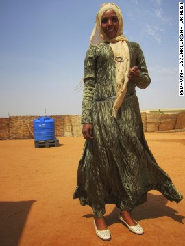"He describes the way women in Darfur dress as ""colorful, unique, proud and fashionable."""