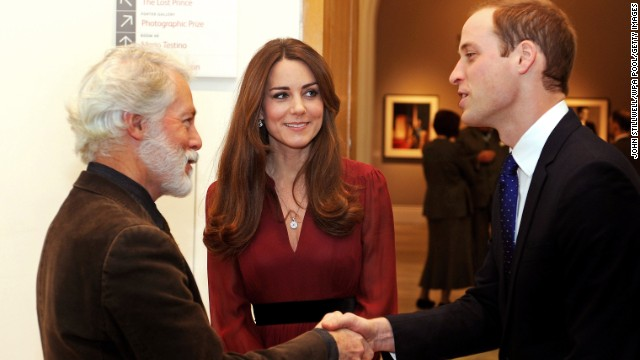 Prince William shakes hands with artist Paul Emsley as Catherine looks on after viewing his new portrait of the Duchess during a private viewing at the National Portrait Gallery on January 11.
