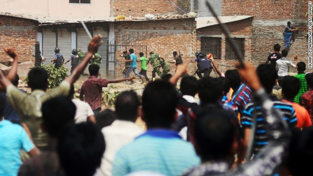 Bangladeshi army personnel and police from villagers on Friday, April 26, after protests broke out at the site of a building collapse 48 hours earlier in Savar, outside Dhaka.