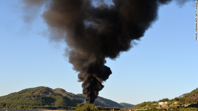 A smoke cloud rises from shelling on the the al-Turkman mountains in Syria's Latakia province on Thursday, April 25.