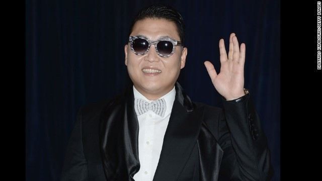 "South Korean singer Psy, known for his song ""Gangnam Style,"" waves from the red carpet."