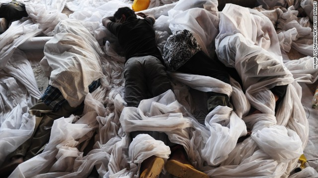 Volunteers sleep before they begin more rescue operations on April 28.