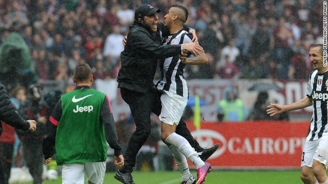 Arturo Vidal celebrates with coach Antonio Conte after opening the scoring for Juventus against Torino.