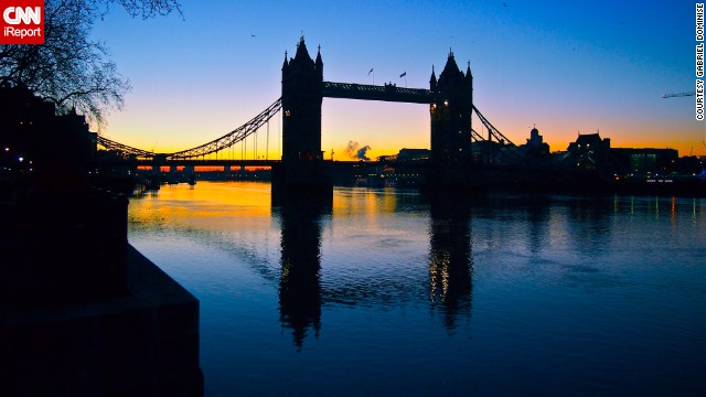 London's Tower Bridge is reflected in the Thames at dawn.