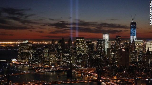 "The ""Tribute in Light"" shines near the spots where the twin towers once stood as red, white and blue light up the new building on the 11th anniversary of the attacks."