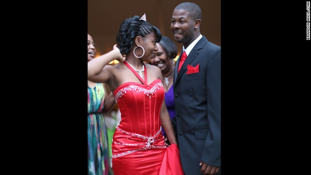 Mareshia Rucker, one of the prom organizers, wore a long, red gown and a small tiara in her hair. Her boyfriend, Mercer University student Arkel Bennett, wore a matching vest and tie. Mareshia's grandmother has sewn formal dresses for her to wear to the JROTC ball in the past; this time, her dress was donated.