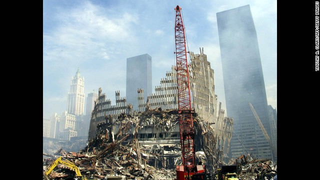 A crane works on the remains of one of the twin towers on September 18, 2001.