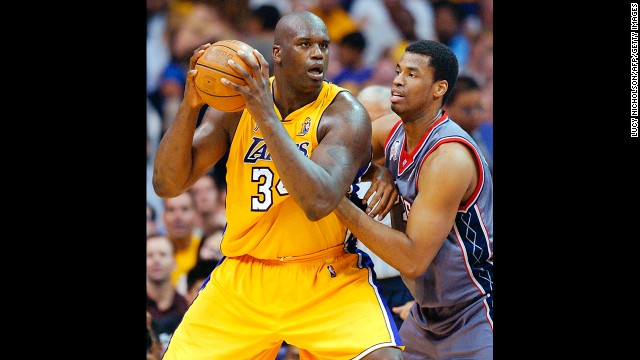 With the New Jersey Nets, Collins guards the Lakers' Shaquille O'Neal in 2002 in Los Angeles. Collins played for the Nets from 2002 through 2008.
