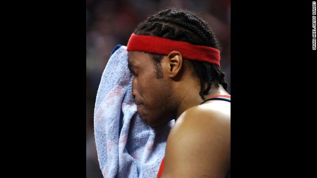 Collins wipes his face after Game Five of the Eastern Conference Quarterfinals during the 2007 NBA Playoffs in Toronto.