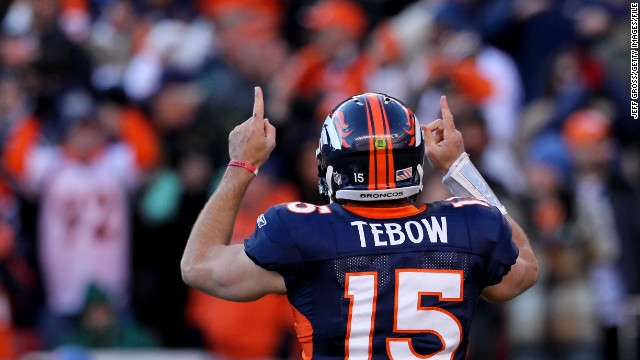 Bronco quarterback Tebow celebrates after running the ball in the end zone for a touchdown in the second quarter against the Pittsburgh Steelers during the AFC wild card playoff game in January 2012 in Denver. The Broncos defeated the Steelers in overtime 23-29.