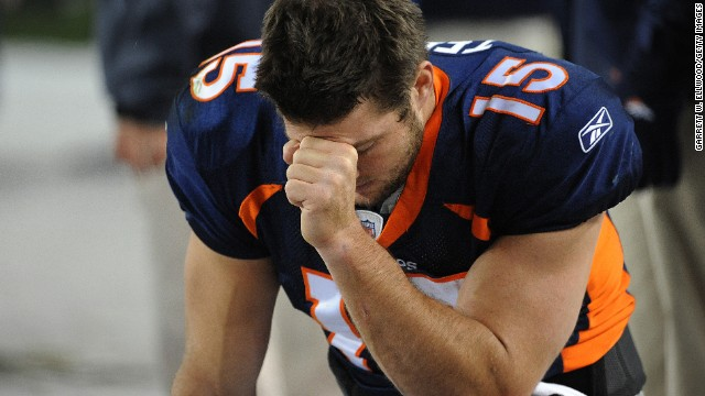 "Tebow prays during the final minute of a game against the New York Jets in November 2011 in Denver. The pose, now famous, has come to be known as ""Tebowing."""