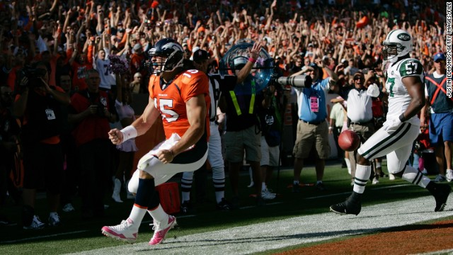 Tebow celebrates his first NFL touchdown run in the first half against the Jets in October 2010 in Denver.