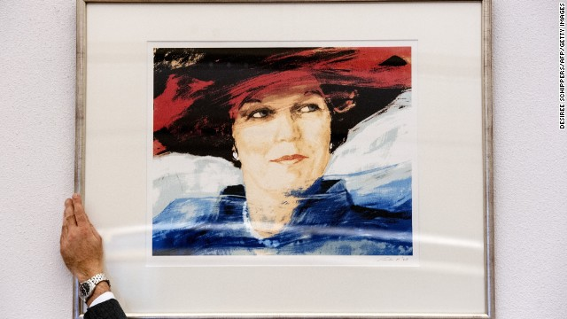 An employee removes a portrait of Beatrix in a Rotterdam courtroom on April 26, ahead of her abdication.