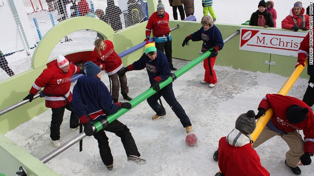 Residents play a game of human table football during the Quebec winter carnival in Quebec City. Carnaval du Quebec is held every February in Quebec City, and the success and sheer size of the event is a testament to Quebecers' defiance toward the cold.<!-- -->