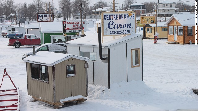 Ice fishing cabins sit near the Sainte-Anne River in Sainte-Anne-de-la-Pérade in the Mauricie region of Quebec. Wherever there's a frozen lake in Quebec, expect to see a handful of temporary huts over it.