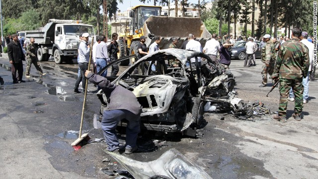 Cleaning takes place following another explosion in an upscale Damascus neighborhood on Monday, April 29. Syrian Prime Minister Wael al-Halqi survived the bombing targeting his motorcade.
