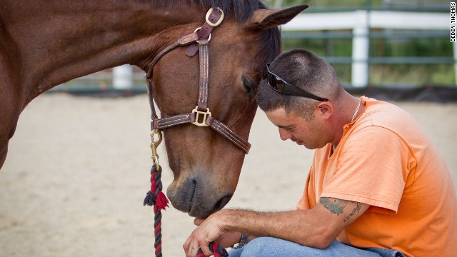 "David and Ace of Hearts, which is waiting for adoption, share a moment. ""Every time I go to the barn, I can tell someone has changed by being around these horses,"" Tucker said."