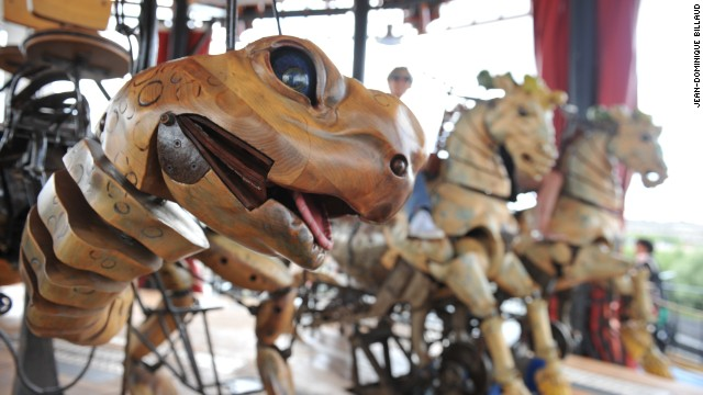 Mechanical turtle and horses on a merry-go-round.