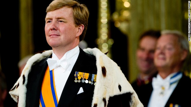 King Willem-Alexander stands during the investiture ceremony.