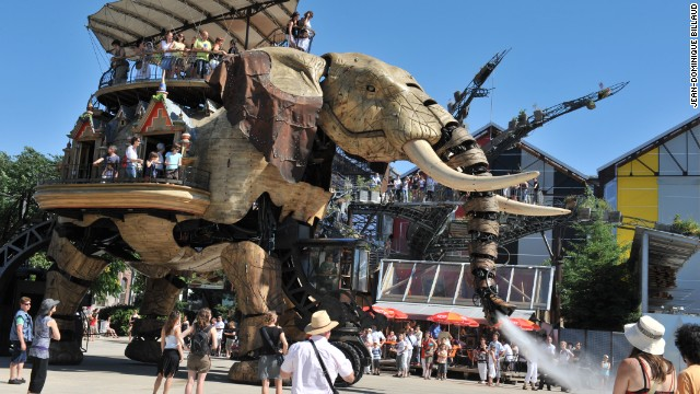 The 12 meter-tall hydraulic mammal tramples his way around the park, carrying almost 50 passengers on its back -- and spraying unsuspecting visitors with water as he passes.