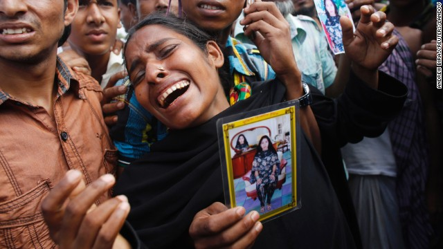A woman mourns before a mass burial in Dhaka on Wednesday, May 1.