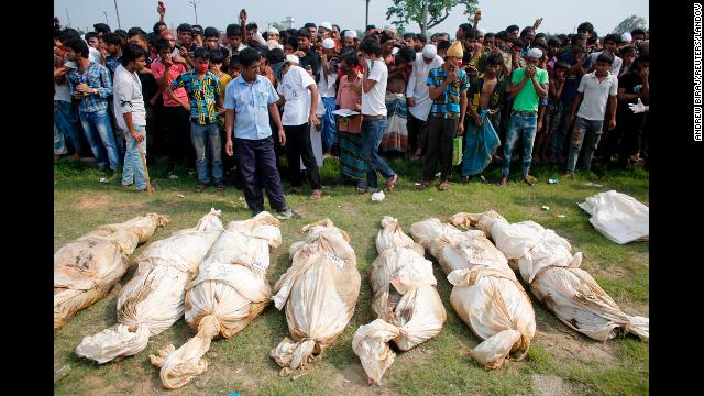 Unidentified bodies from the rubble lie on the ground as people gather for a mass burial in Dhaka on May 1.
