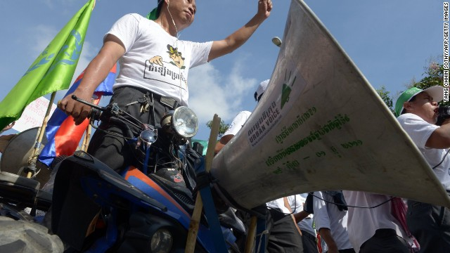 A Cambodian worker stands on a vehicle as he attends a May Day protest in Phnom Penh.