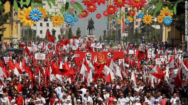 Supporters of the nationalist party Red and Black march in Tirana, Albania during a May Day protest demanding the resignation of Premier Sali Berisha.