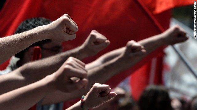 Participants raise their fists during a demonstration in Athens.