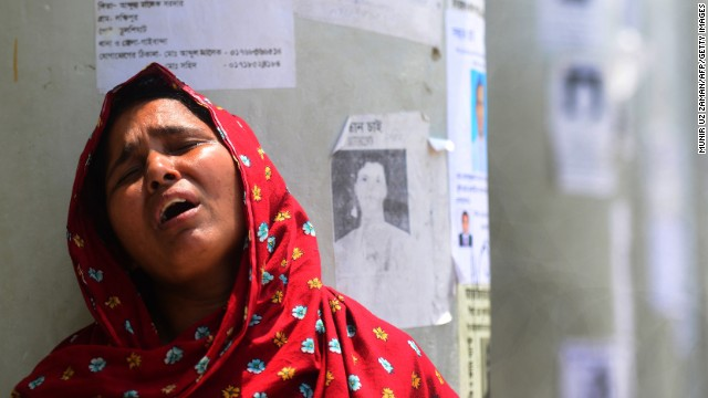 A woman weeps after identifying her daughter's body in the rubble in Savar on May 2.
