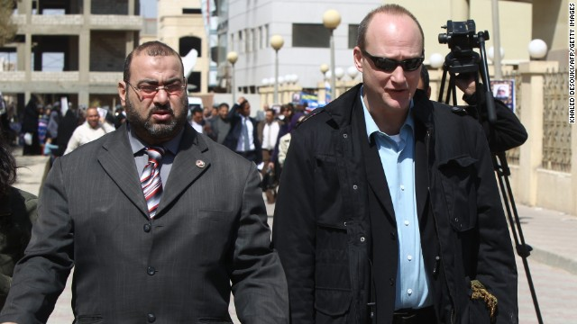 Sixteen Americans were among the dozens arrested in December 2011 when Egypt raided the offices of 10 nongovernmental organizations that it said received illegal foreign financing and were operating without a public license. Many of the employees posted bail and left the country after a travel ban was lifted a few months later. Robert Becker, right, chose to stay and stand trial.