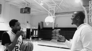 Coach Penny provides tips to Reggie Green. Under Penny\'s leadership, Reggie\'s game improved along with his grades.