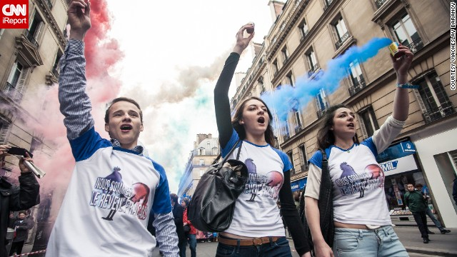 Hundreds of supporters of Marine Le Pen, leader of France's far-right National Front party, took to the streets on May Day Wednesday as part of the day's celebrations in images captured by iReporter Batareykin.
