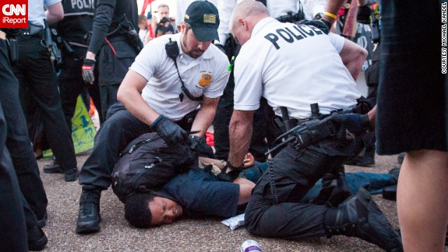 Photographer Michael Kandel was out at the May Day protest in Washington yesterday evening when protesters veered off the marching path and stormed a GAP store. Police intervened to secure the entrance and a skirmish broke out, according to CNN.