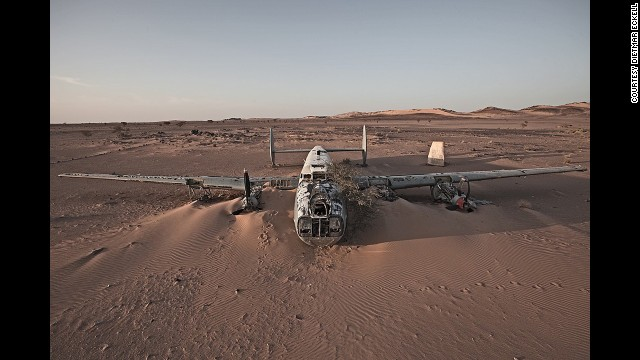 "An Avro Shackleton, a British-made maritime patrol aircraft, is swallowed by the sand in Western Sahara. A local rebel group helped Eckell reach the site from Mauritania. ""We had to go cross-country, as the military would stop us on the gravel roads -- a different kind of thrill."""