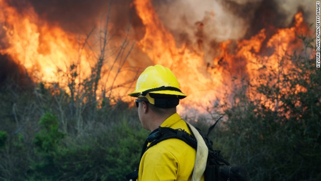 A firefighter prepares to push back against the flames in Camarillo on May 2.