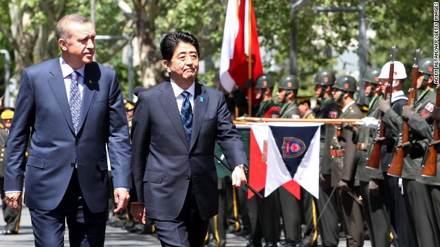 Japanese PM Shinzo Abe, right, and his Turkish counterpart Recep Tayyip Erdogan review an honor guard in Ankara on May 3.